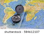 compass and the map of the... | Shutterstock . vector #584612107