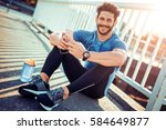 young male jogger athlete... | Shutterstock . vector #584649877