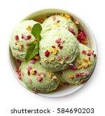 bowl of green pistachio ice... | Shutterstock . vector #584690203