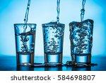 transparent three vodka shots.... | Shutterstock . vector #584698807