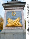 Small photo of ST PETERSBURG, RUSSIA -OCTOBER 3, 2016. Allegorical composition with trophies at the stone panel on the monument to Peter I in St Petersburg, Russia