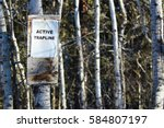 Small photo of Sign on an Active Trapline in the Woods