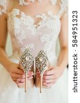 Wedding Shoes In Brides Hands