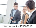 consulting team with tablet... | Shutterstock . vector #585006913