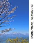 mt.bandai and inawashiro lake ... | Shutterstock . vector #585009343