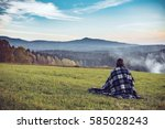 woman sitting and looking on... | Shutterstock . vector #585028243