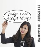 Small photo of businesswoman holding a marker pen writing -judge less accept more
