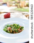 Small photo of Selective focus on Thai style beef salad with green herb abd spicy taste in white plate.
