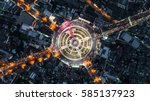 road roundabout with car lots... | Shutterstock . vector #585137923
