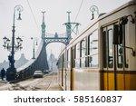 a tram entering liberty bridge... | Shutterstock . vector #585160837