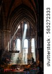 Small photo of BAMBERG, GERMANY - Circa September, 2016:Beams of light pour in through chapel windows above altar and pews with large chandelier hanging overhead