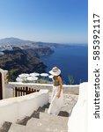 attractive woman walking in... | Shutterstock . vector #585392117