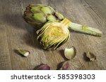 artichokes sliced on wooden...   Shutterstock . vector #585398303