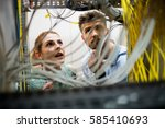 technicians fixing cable in... | Shutterstock . vector #585410693