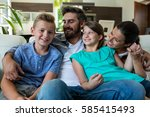 happy family sitting with arm... | Shutterstock . vector #585415493