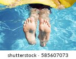 teenager swims on a mat  in the ... | Shutterstock . vector #585607073