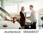 salesperson selling cars at car ... | Shutterstock . vector #585608537