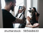 girl with a dog posing by the... | Shutterstock . vector #585668633