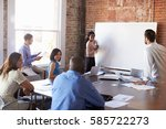 businesswoman at whiteboard in... | Shutterstock . vector #585722273