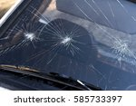 broken windshield on car | Shutterstock . vector #585733397