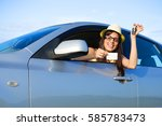 happy successful female driver... | Shutterstock . vector #585783473