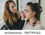 makeup artist making... | Shutterstock . vector #585799163