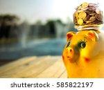 the money jay on golden piggy... | Shutterstock . vector #585822197