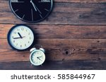 many different clocks on wooden ... | Shutterstock . vector #585844967