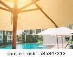 umbrella deck chair pool | Shutterstock . vector #585847313
