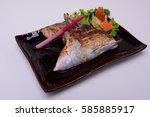 Small photo of Buri-Kama Shioyaki ,Broiled Yellowtail Collar Shio-Yaki , Traditional Japanese food isolated on white background