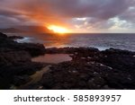 Stock photo queen s bath on sunset on the island of kauai hawaii the pools are sinkholes surrounded by lava 585893957