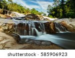Small Waterfall And Stone With...