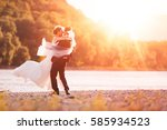 just married couple spinning on ... | Shutterstock . vector #585934523