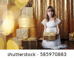 young girl with gold gift boxes ... | Shutterstock . vector #585970883