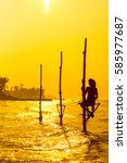 Small photo of Sri Lanka's traditional Fisherman on sunset. Fishing on silt is very common in many Asian countries but most of all - in Sri Lanka