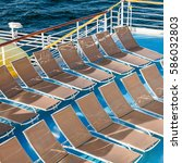 Small photo of above view of empty chairs in sunbathing area on stern of cruise liner