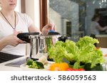 woman uses pressure cooker to... | Shutterstock . vector #586059563