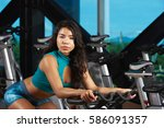young woman working out on bike ... | Shutterstock . vector #586091357