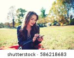 happy charming hipster girl is... | Shutterstock . vector #586218683