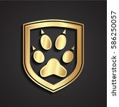 3d golden metal shield paw logo | Shutterstock .eps vector #586250057
