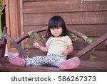 portrait of asian little girl... | Shutterstock . vector #586267373