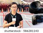 female journalist outside... | Shutterstock . vector #586281143