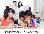 asian kids playing tablet... | Shutterstock . vector #586297253