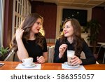 Two Beautiful Girls Drinking...