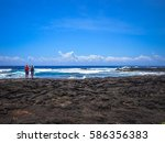 black sand beach on the big... | Shutterstock . vector #586356383