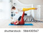 couple yoga sessions at home in ... | Shutterstock . vector #586430567