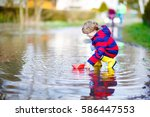 happy little kid boy in yellow... | Shutterstock . vector #586447553