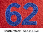 Small photo of Number sixty-two blue color over a red background. Anniversary. Horizontal