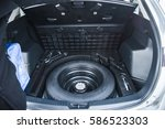spare tire in the trunk of a... | Shutterstock . vector #586523303