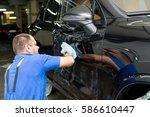 man on a car wash polishing car ... | Shutterstock . vector #586610447